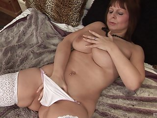 Solo matured in white stockings carrying-on with her favorite dildo