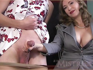 Experienced woman is giving a gentle handjob approximately a handsome guy, in front of the camera