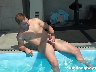 Gay lad jerks off by the pool in a sensual solo
