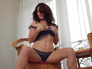 Elegant Russian woman over 40 shows lampoon and masturbates pussy