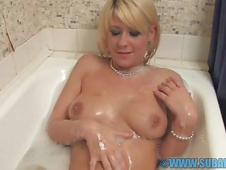 Horny girl Lilly White spreads her legs to masturbate in the mouthwash